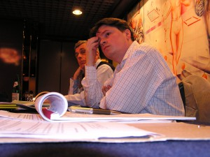 First SCOOP network meeting in Belgrade 2005. Henrik Kaufholz (left) from the Danish Association for Investigative Journalism listens together with Milorad Ivanovich, SCOOP coordinator for Serbia.